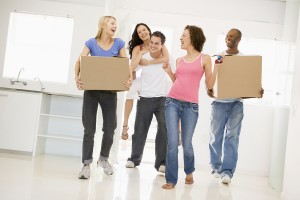 bigstockphoto_Group_Of_Friends_Moving_Into_N_4637146